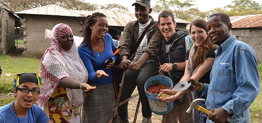 Image: International design team from International Development Design Summit 2014 tests low-cost coffee bean sheller prototype with farmers in Tanzania.